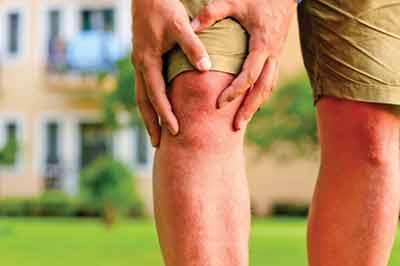 bigstock-man-holding-hands-sore-knee-48283817