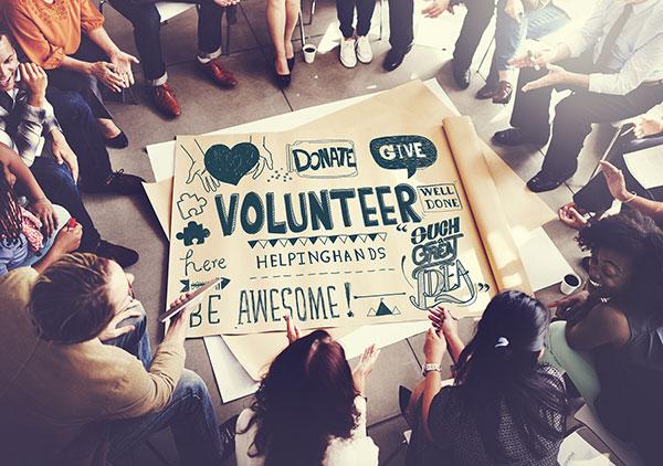 bigstock-Volunteer-Charity-Helping-Hand-124706429.jpg